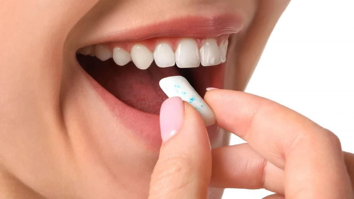 Lady Chewing Sugarless Gum