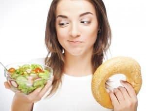Patient Choosing Between A Fad Diet And Healthy Diet For Stronger Gums